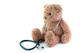 teddy bear and stethescope